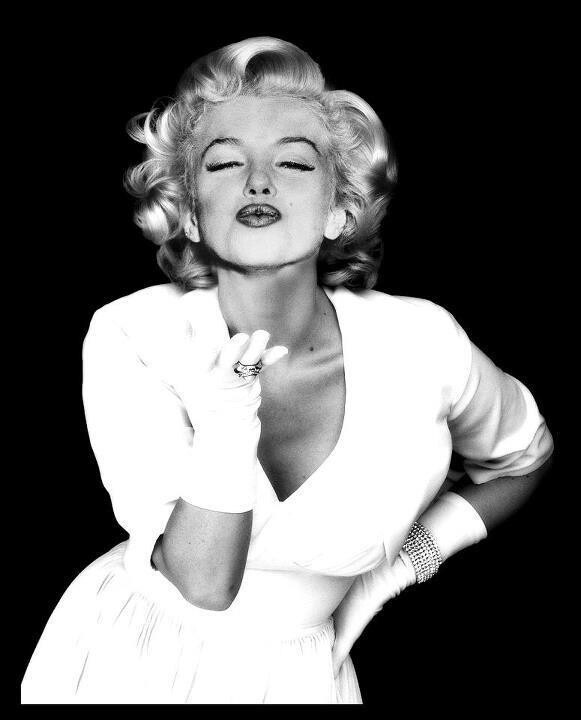 Marilyn Monroe blows a kiss